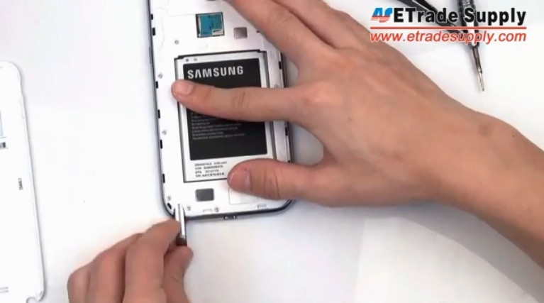 put back Galaxy Note II battery and battery door