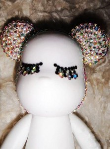 Paste the rhinestones on the whole head part of the teddy bear