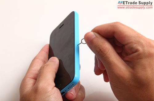 Turn off the iPhone 5C and use eject pin to take out the SIM card tray