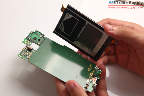 Separate the Moto X battery from motherboard