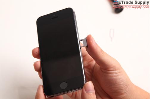 insert the SIM card tray