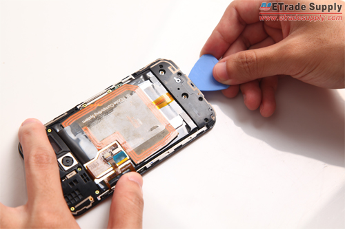 Remove the Moto X bottom cover