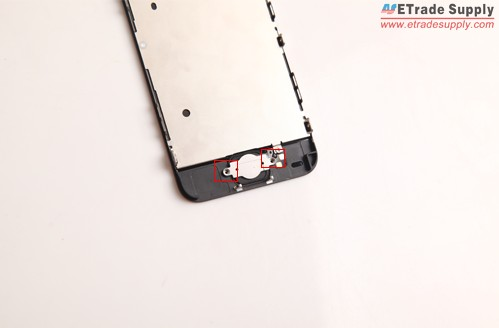 Undo 2 screws on the metal shield to remove the home button