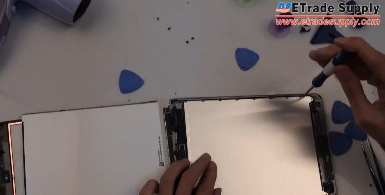 undo seven screws on the LCD metal shield