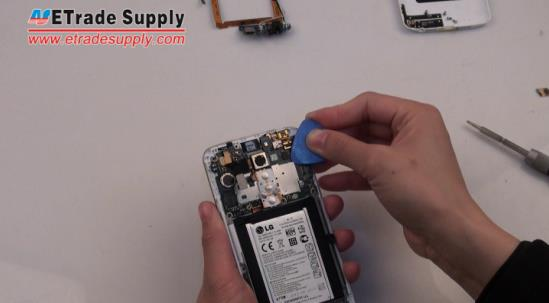 Peel off the LG G2 power button and volume button