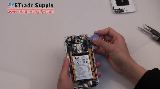release the LG G2 charging port flex cable ribbon