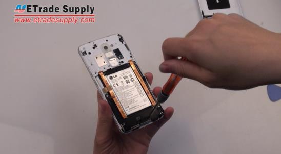 unscrew five screws of LG G2 antenna module