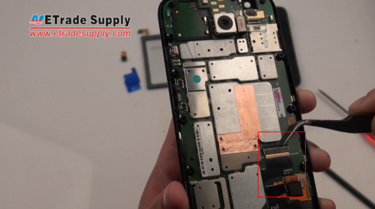 Disconnect the Moto G screen connector with the tweezers