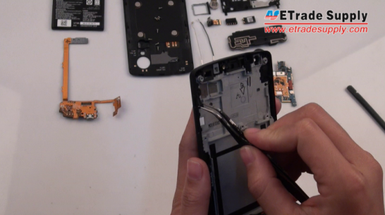 Peel off the Nexus 5 power button and volume button