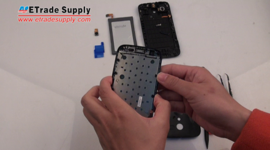 Take a Motorola Moto G LCD screen assembly with front housing