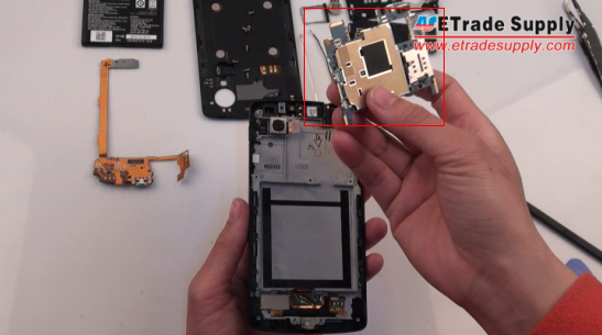 lift the metal shied underneath the Nexus 5