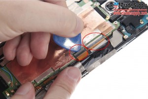 Pry up the 6 connectors with a Case Opening Tool