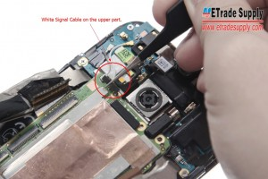 Pry up the two White Signal Cables on both upper and bottom parts