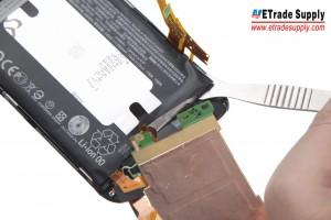 Use the Metal Spudger Opening Tool to pry up the motherboard and then the battery
