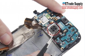 Pry up the Rear Facing Camera and then the Motherboard Flex