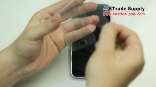 peel the protective layer off the adhesive side