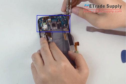 undo-five-screws-motherboard-flex-cable-ribbon