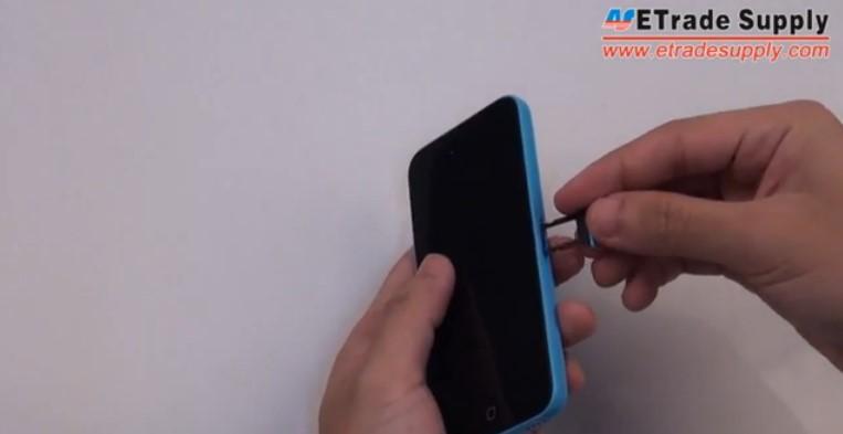 Insert the iPhone 5C SIM card
