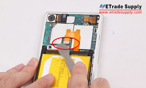 Pry up the battery flex connector, then pry up the battery gently