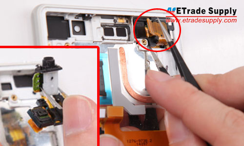 Pry up the connector and take out the earphone jack module