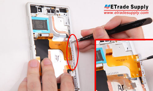 Loosen and take out the charging port flex cable ribbon