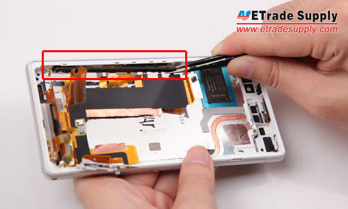 Take out the power button and camera button retaining bracket