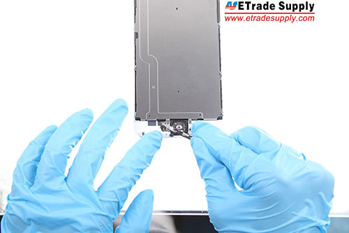 Assemble the metal plate and the LCD display and connect the flex cable.