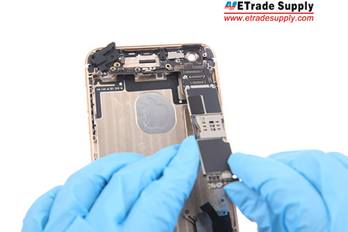 Put the motherboard in the slot. (notice take care of the volume flex cable and power flex cable in the top of the phone to avoid covering them.)