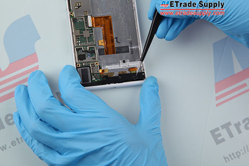 Undo 3 screws in the bottom of the phone and remove the black plastic retaining bracket.-