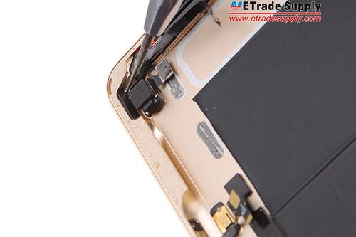 18.Undo 2 screws in the power button bracket.