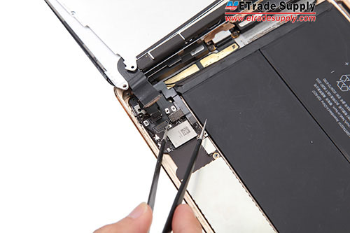 7..Remove the metal bracket and disconnect 4 flex cables connecting to the logic board
