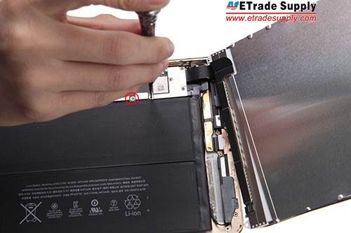 Fasten the mother board with a screw into the back housing.