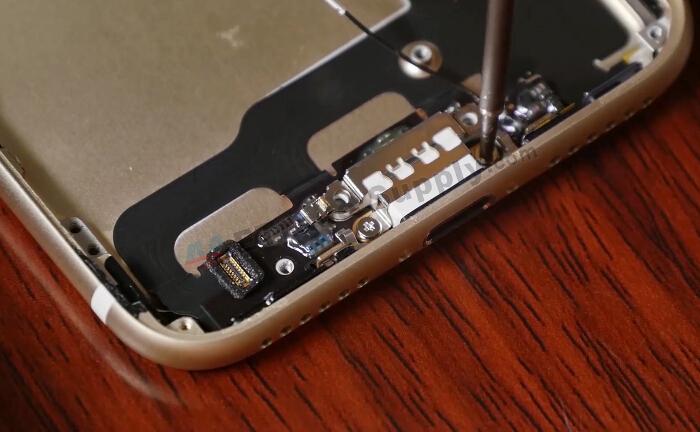 undo charging port screw