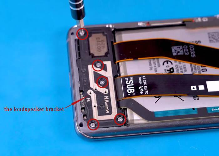 Loosen the five screws and remove the loudspeaker bracket