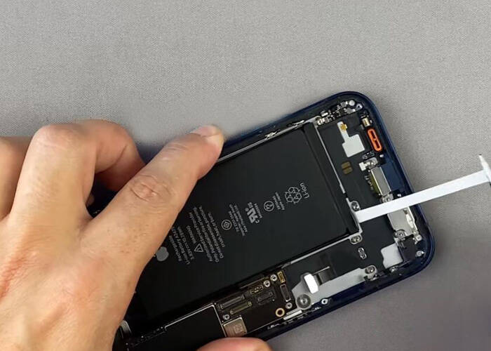 Tear off the battery adhesive sticker