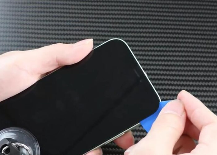Slice around to separate the iPhone screen