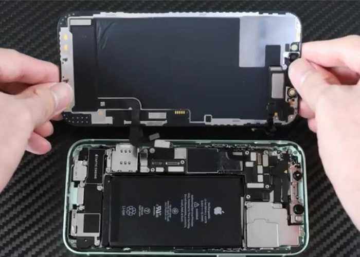 Disconnect the ear speaker flex and separate the iPhone 12 screen