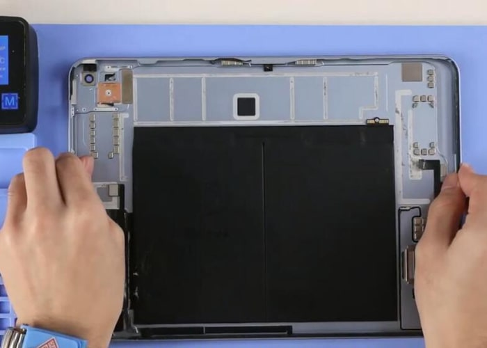 Place the iPad back cover onto the heating station